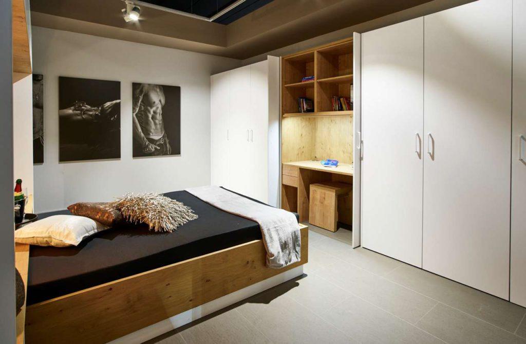 Apartment Sachsenküchen, Schlafbereich mit Arbeitsplatz. Foto: Sachsenküchen