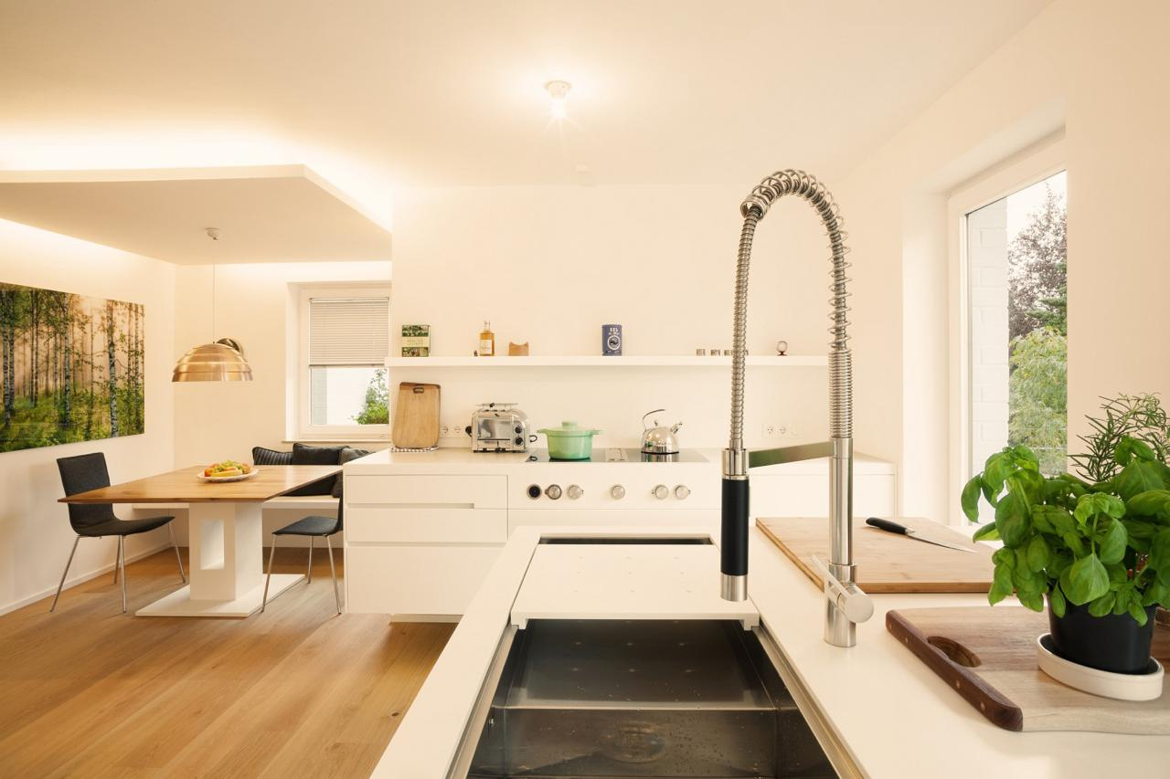 plan 3 kueche stadler halbinsel zeile corian holz 05. Black Bedroom Furniture Sets. Home Design Ideas
