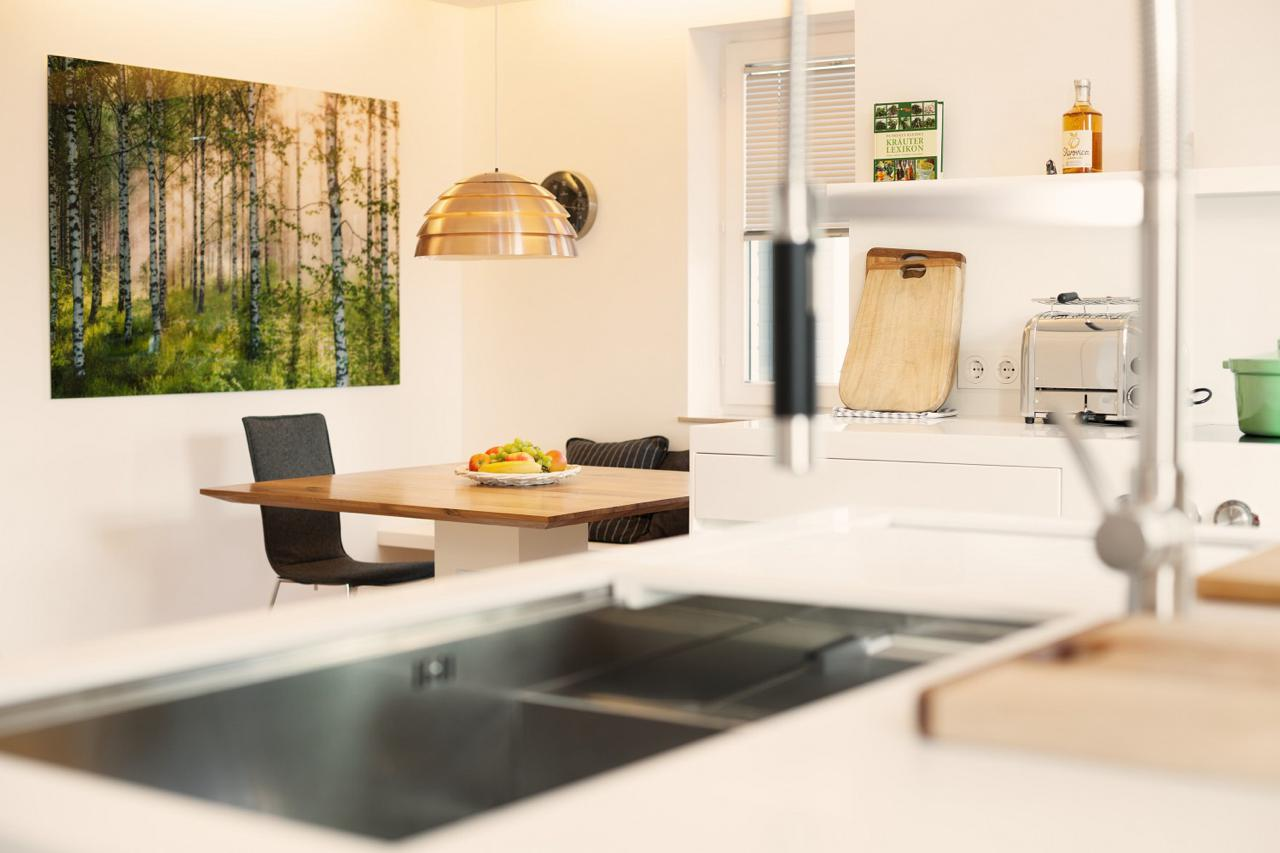 plan-3-kueche-stadler-halbinsel-zeile-corian-holz-10 – Küchen Journal