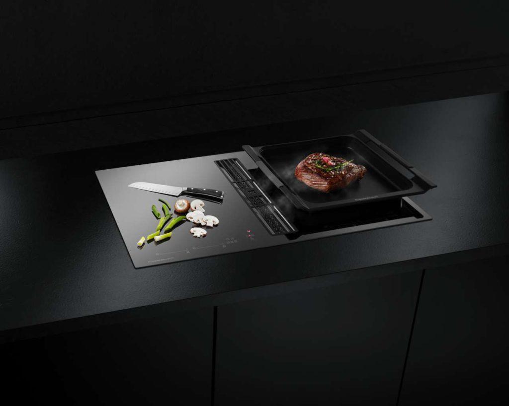 Das neue Induktions-Kochfeld mit integrierter Muldenlüftung KMI 9800.0 Die patentierte SCHOTT CERAN® Miradur TM Beschichtung reduziert nicht nur Gebrauchsspuren durch Reinigen und Kochen, es sichert damit, dass das Kochfeld auch nach vielen Jahren wie neu aussieht. Foto: Küppersbusch
